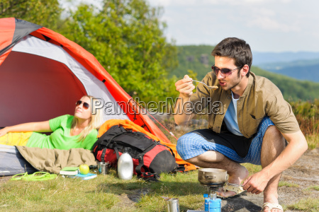 camping young couple with tent cook
