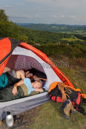 camping young couple sleeping tent climbing