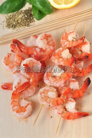 shrimps lemon and basil on board