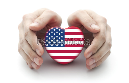 hands covering us heart on white