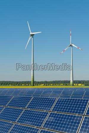 wind turbines and solar panels against