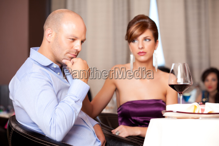 couple having an argument at restaurant