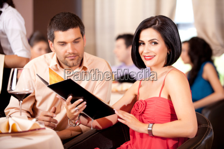 young couple ordering food restaurant table