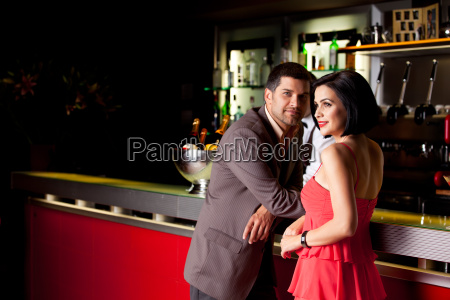young couple in bar talking