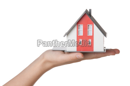 hand with house