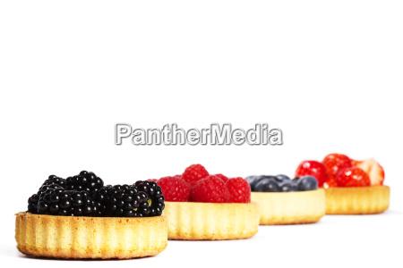 in tartelettes berries blackberries in front