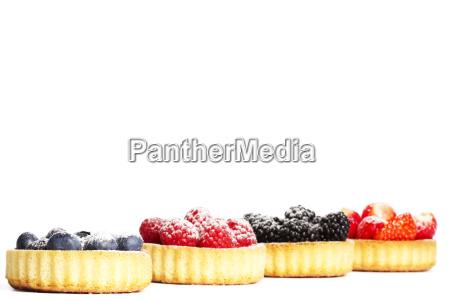 sugared blueberries on tartelette cake berries
