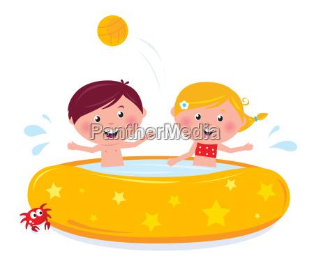 little girl and boy splashing in