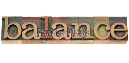 balance word in letterpress type