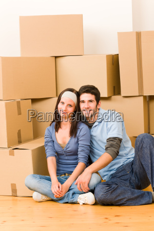 moving new home young couple sitting