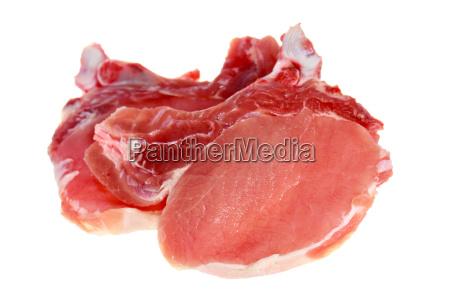 schweinefleisch roh kotelett isoliert auf weiss