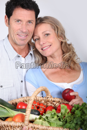 couple with vegetable basket