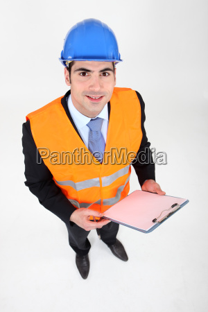 businessman taking notes on a construction