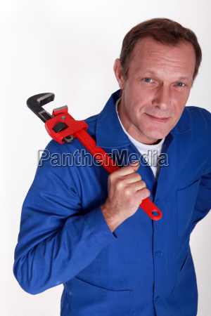 plumber with a large adjustable wrench