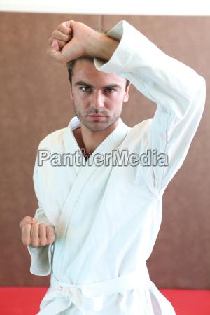 man wearing martial arts clothing stood