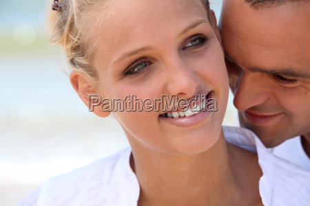 man nuzzling his wife039s neck