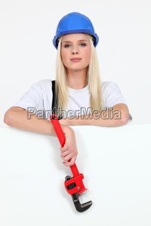 beautiful female laborer in dungarees