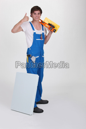 young plasterer with tools of the