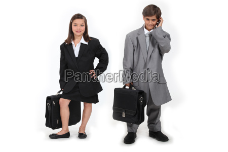 children wearing suits