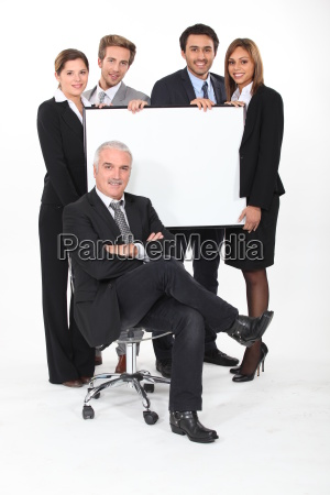 four young executives holding a blank