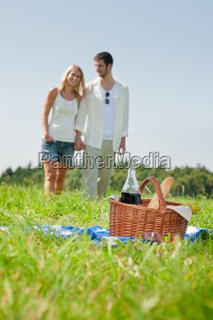 picnic basket romantic couple holding