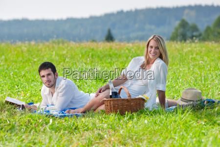 picnic romantic couple read book
