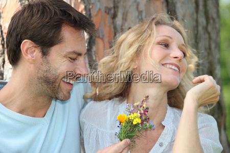 husband offering wife flowers