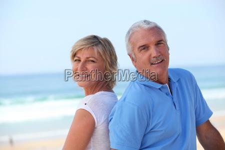 happy senior couple on the beach