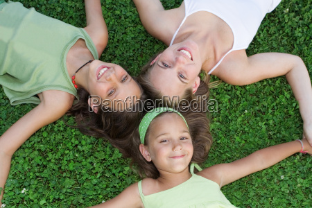 family happy group of smiling sisters
