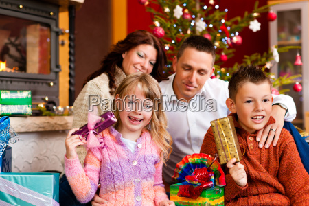 christmas family with gifts on