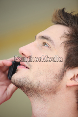 close up of man on mobile
