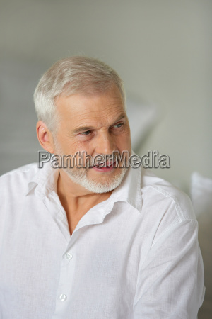 grey haired man giving advise
