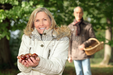 mature woman in woods with husband