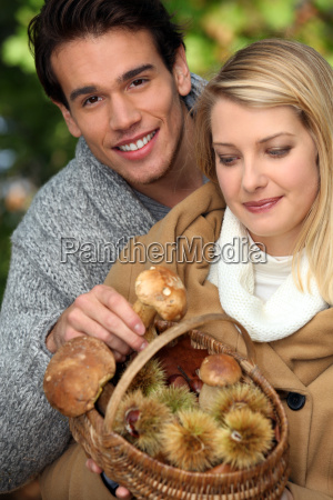 couple gathering mushrooms