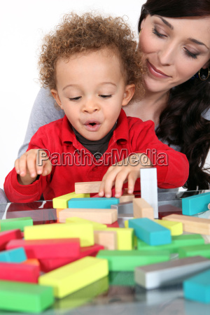 woman with child and blocks