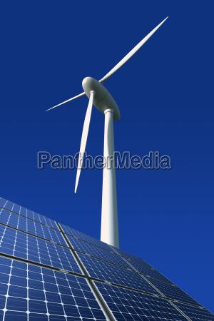 solar panels and wind turbine against