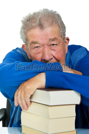 senior resting on a books stack