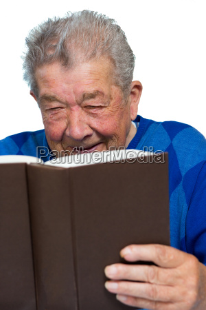 senior enjoys reading a book