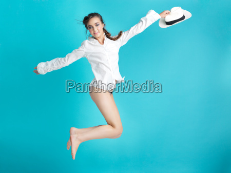 happy woman jumping blue background white