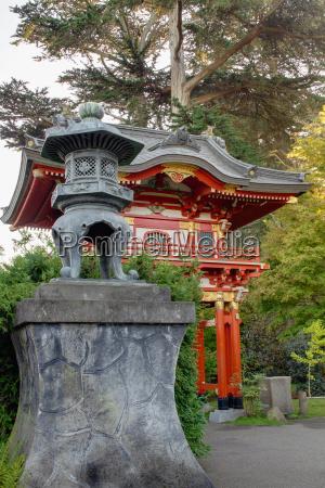 bronze lantern by pagoda in japanese
