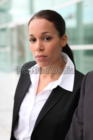 businesswoman outside an office building