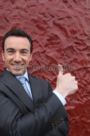 businessman giving the thumbs sign