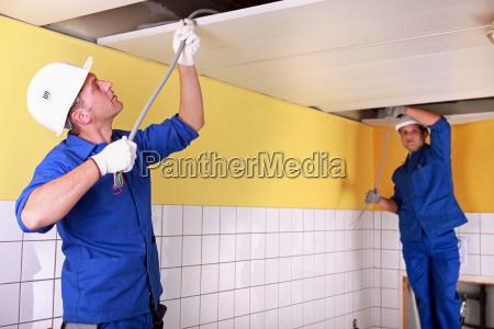 duo of electricians working indoors