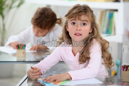 two kids studying in a classroom