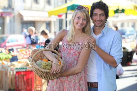 couple at a market with basket