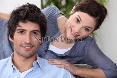 a nice couple on their sofa