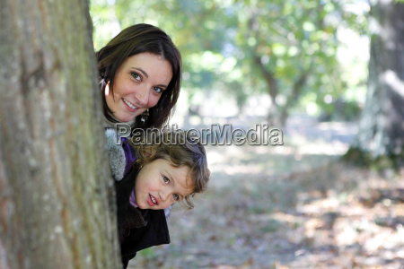 mum and daughter hiding behind a