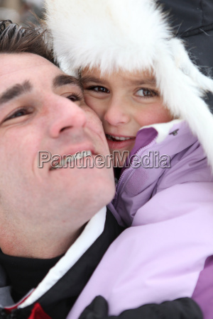 father and daughter in ski holidays