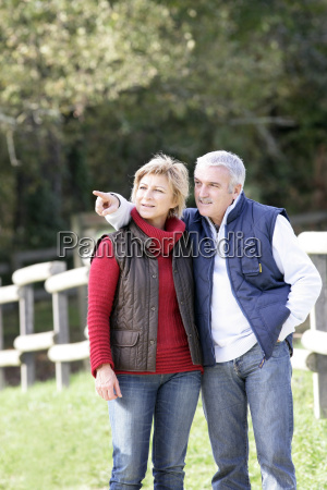 couple taking a walk through park