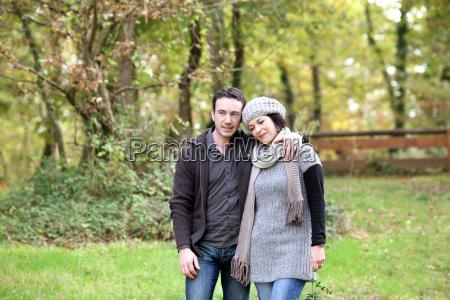 couple taking an autumn stroll